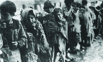 Photo of a Line of Orphans in Front of an Orphanage